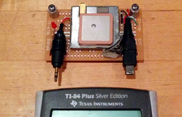 GPS module above TI-84 Plus Silver Edition graphing calculator
