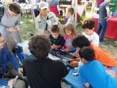 Thomas oversees a group of future programmers.