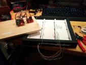 Working on constructing the physical Whack-a-Mole interface, with nine connected light sensors (CDS cells)